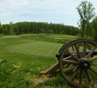 A cannon is positioned behind the 14th green at Cannon Ridge Golf Club in Fredericksburg, Virginia.