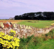 "The par-3 sixth hole at Craigielaw Golf Club plays along a stone wall and is named ""Kilspindie."""