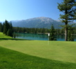 The par-4 14th hole at Jasper Park Lodge Golf Course plays over and around a glacial-formed lake.