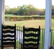 Golfers love to sit on the porch to watch players come up the 18th at the Caledonia Golf & Fish Club.