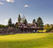 The clubhouse at River's Edge Golf Course features a practice area in the front.