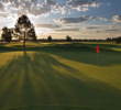 The first green on the Resort Course at Eagle Crest Resort shines at sunrise.
