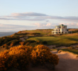 The Art Deco clubhouse at Castle Stuart rises from the landscape like a ship sailing upon waves of fescue.