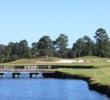 The sixth hole at King's North at Myrtle Beach National has an island fairway as well as an semi-island green.