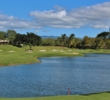 A large pond comes into play on several holes on the back nine at Ewa Beach, like the par-5 10th hole, seen here.
