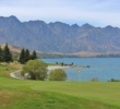 The fifth hole at Queenstown Golf Club boomerangs around the lake.