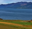 The par-3 seventh hole at Jack's Point Golf Course overlooks Lake Wakatipu.