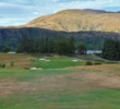A mountain backdrop accompanies the eighth hole on the Remarkables nine at Millbrook Resort.