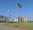 Flags in front of the clubhouse at World Tour honor the countries and states of the courses represented here.