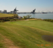 Views of the Elizabeth River, as well as those of ship-loading cranes, are commonplace at unique Lambert's Point Golf Club.