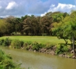 The seventh hole of the River Course at Rio Mar Country Club plays along the Mameyes River.