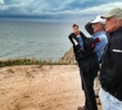 Bill Coore & Ben Crenshaw survey the site of Cabot Cliffs during a recent visit.