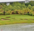 A lake and a handful of bunkers combine for a rousing start to the round on the first hole at Nayar Golf Course.