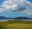 The 18th green sits steps from the clubhouse and the beach at Waterville Golf Links in Co. Kerry, Ireland.