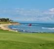 The par-4 17th hole on the Bahia golf course at Punta Mita resort sweeps along the shore of the Pacific Ocean.