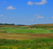 The opening hole at Erin Hills is a moderately difficult par 5.