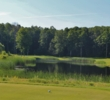 A pond makes for a demanding tee shot on the par-4 seventh hole of the Cedar River golf course at Shanty Creek Resorts.