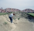 "Ian Woosnam hits a bunker shot on the Ocean Course at Kiawah Island Resort during the in the 1991 Ryder Cup Matches, AKA the ""War by the Shore."""