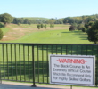 The sign at the first tee says it all about Bethpage Black.