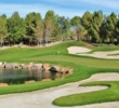 A pond protects the first green at Southern Highlands Golf Club in Las Vegas.
