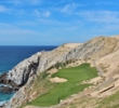 The par-3 sixth hole at Quivira Golf Club plays to an oceanfront green cut from a mountainside.