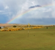 A rainbow lights up the background of the eighth green at Newburgh-On-Ythan Golf Club.