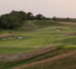 The fairway of the 478-yard, par-4 third at Erin Hills cants from right to left, from fescue to thick brush. Fortunately the fairway looks wide, even from far above on the elevated tees.