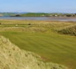 The sixth hole of the Old Tom Morris Links at Rosapenna Hotel & Golf Resort plays to a green set in wild dunes.