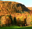 The downhill and drivable par-4 eighth at Cape Breton Highland Links is dressed in prime fall color.