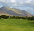 Mountains form the backdrop of Steenberg Golf Club near Cape Town, South Africa.