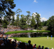 Patrons watch the play during the Par 3 Contest prior to the start of the 2015 Masters Tournament at Augusta National on April 8, 2015.