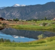 The mountains reflect in the pond guarding the eighth hole on the Ranch Course at Genoa Lakes Golf Club in Nevada.