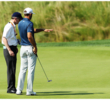 A rules official from the USGA discusses a ruling with Dustin Johnson on the fifth green of Oakmont C.C. in the final round of the U.S. Open.
