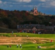 Erin Hills' 18th hole features Holy Hill Cathedral in the background.