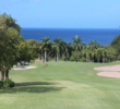 The 15th hole at the Four Seasons Resort Nevis golf course plummets downhill off of Mount Nevis.