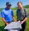 Tiger Woods and Johnny Morris look at plans for the new Payne's Valley at Big Cedar Lodge near Branson, Mo.