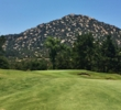 Mt. Woodson, a popular hiking destination, frames many of the holes at the Mt. Woodson Golf Course outside San Diego.