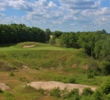 The par-3 15th hole at the Wild Rock Golf Club plays over a quarry.