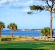 If you look beyond the 14th green at Haig Point on Daufuskie Island, you can see the red and white lighthouse at Harbour Town Golf Links at Sea Pines Resort on Hilton Head Island across the Calibogue Sound.