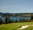 The par-3 third hole at Gozzer Ranch Golf and Lake Club plays to a green overlooking Lake Couer d'Alene.