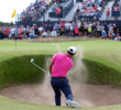 Bunkers are true hazards at Carnoustie, as Xander Schauffele encountered numerous times in the final round, including this awkward stance on the par-5 6th hole.