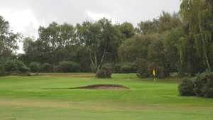 Bunker lined green at the Wirral Ladies GC