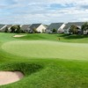 A view of a green with houses in background at Heritage Hunt Golf Club.