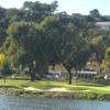 An inlet fronts the 166-yard, par-3 16th hole at Peacock Gap Golf Club in San Rafael.
