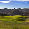 The green slopes from front to back on the third hole of the Shadow Course at Lost Canyons Golf Club.