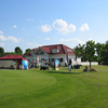 A view of the clubhouse and putting green at Berlin Pankow Golf Resort