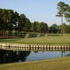 A view of green surrounded by water at Reedy Creek Golf Course
