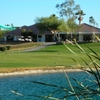 A view over the water of the clubhouse and putting green at Rio Salado Golf Course