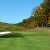 A view of the 2nd green with bunker on the left at Hilltop Golf Club