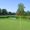 A view of green with water in background at Virginia National Golf Club